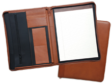 inside and outside views of ziparound leather padfolios, shown in black, brown and tan